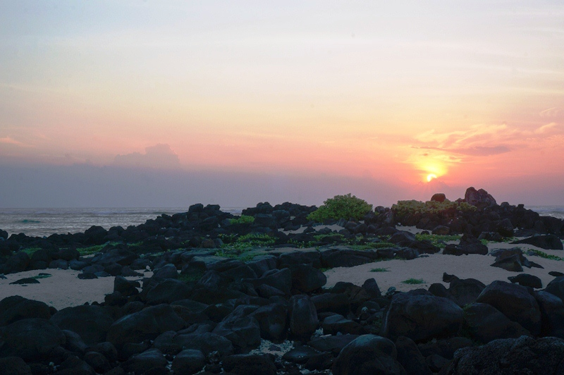 Dawn on Mu Cu islet with unique black lava stones. The islet is about 3.2km east of Ly Son island district centre, where tourists can enjoy the most beautiful sunrise on the island.
